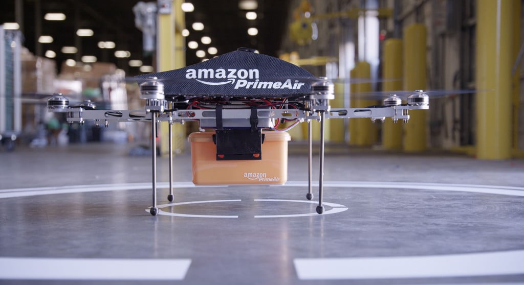 Amazon Prime Air Drone with package in an Amazon warehouse facility just before takeoff for delivery.
