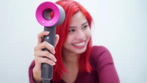 Girl using Dyson Supersonic