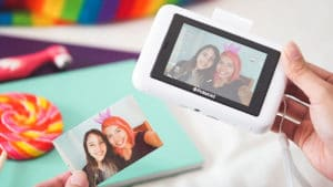 Polaroid Snap Touch side by side with a printed photo